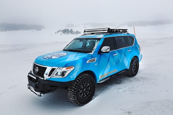 Blizzard Blue Nissan Armada Tows Track-Equipped Nissan 370Zki